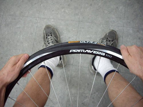 stretch tire bead fully onto rim